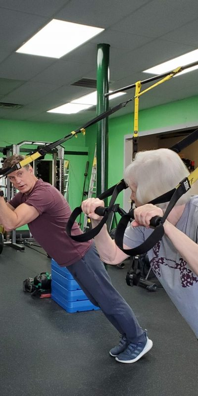 older woman and and John on TRX